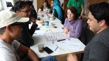 Flüchtlinge lernen spielerisch Deutsch